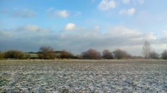 Slow passage through landscape with field and a little snow Stock Footage