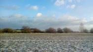 Stock Video Footage of Slow passage through landscape with field and a little snow