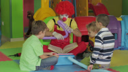Stock Video Footage of Clown amusing kids boys