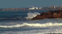 Surfers riding  big waves at cabo de  sines in portugal Stock Footage