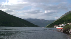 Ferry departs from southern side on Kotor Bay Stock Footage