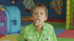 Young boy with party noise maker Stock Footage