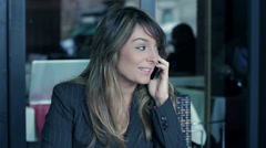 Attractive businesswoman using a mobile phone Stock Footage