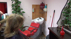 Zoom out head wash sink and barber dry client girl hair Stock Footage