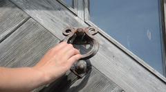 Guest hand knock retro rusty door handle used as ringer knocker Stock Footage