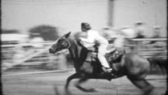 703 - yong woman competes in rodeo barrel racing - vintage film home movie Stock Footage