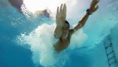 Boy jumping into the pool Stock Footage