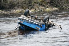 Car in the river upsidedown; head over heels Stock Photos