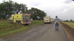 Firefighters barn burning firetrucks Stock Footage