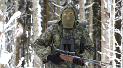 Hunter with optical rifle in winter in the woods episode 5 Stock Footage
