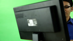 Frustrated business man with computer on green screen Stock Footage