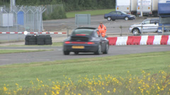 Supercars cornering on track Stock Footage
