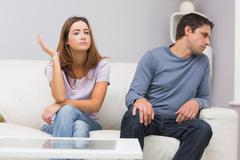 Unhappy couple not talking after argument at home Stock Photos