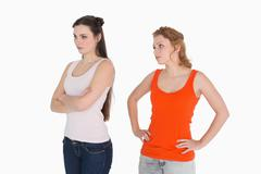 Unhappy young female friends not talking after argument Stock Photos