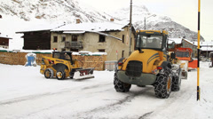 Snowplough clearing winter street Stock Footage