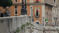 A couple take a break from sight seeing in Rome (lots birds!) - stock footage