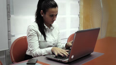 young woman in formalwear computing in office - stock footage