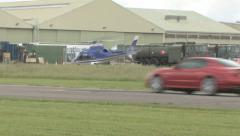 Helicopter and supercars Stock Footage