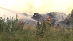 Firefighter1 barn burning ZI-MS Stock Footage