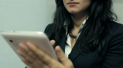 Young attractive business woman holding a tablet computer Stock Footage