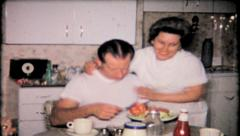 714 - wife serves her husband lunch at the table - vintage film home movie Stock Footage