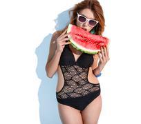 Hungry woman bites watermelon slice Stock Photos