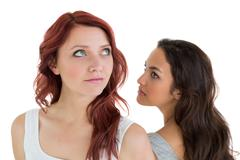 Unhappy young female friends not talking after argument - stock photo