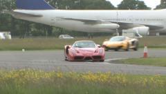 McLaren MP4-12c chasing Ferrari Enzo Stock Footage