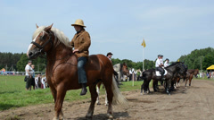 Cowboys on horse, police riders and people in public festival Stock Footage