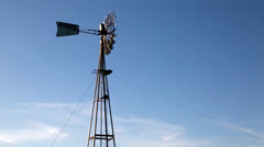 Windmill with blue sky and clouds - stock footage