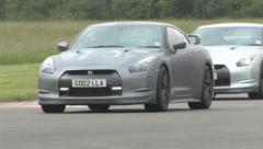 Nissan GTR's on track Stock Footage