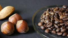 mixture of nuts and dried fruit with coffee beans and othe, walnuts, almonds, - stock footage