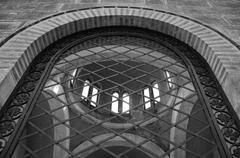 Arched window ironwork pattern Stock Photos