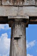 Doric column and faded inscription Stock Photos