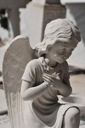 Praying angel statue Stock Photos