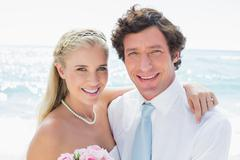 Cute cheerful couple on their wedding day - stock photo