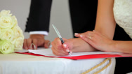 Stock Video Footage of Happy couple signing their wedding register