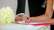 Stock Video Footage of Couple signing their wedding register