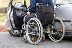 car driver on wheelchair - stock photo