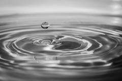 impact instant of a drop of water - stock photo