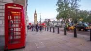 Stock Video Footage of Red Phone Booth on London Street Corner - Timelapse of People in Evening