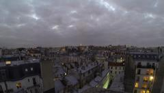 Paris houses at dusk, with Eiffel tower in the background Stock Footage