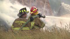 Firefighters2 barn burning fire CU Stock Footage