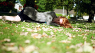 Stock Video Footage of Peaceful napping redhead lying on green lawn
