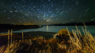 Stock Video Footage of Timelapse Star Trail Over Lake Pukaki 720p