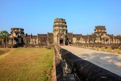 Entrance to angkor wat - stock photo