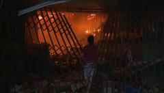Man Attempts To Put Fire Out Aftermath Typhoon Haiyan Tacloban Stock Footage