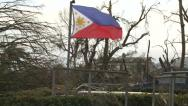 Stock Video Footage of Philippines Flag Flies In Destruction Typhoon Haiyan Aftermath