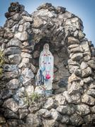 little  virgin mary statue in roman catholic church place belief of community - stock photo
