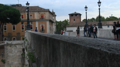 Out of focus tourists on Roman bridge Stock Footage